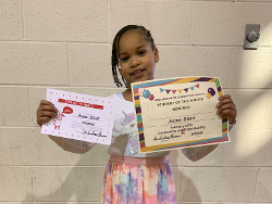 Little Girl with her awards in our Educational Program in Decatur, AL